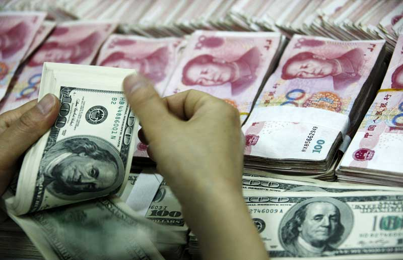 A Bank Clerk Counts Stack Of U S And Chinese Bills At In Huaibei