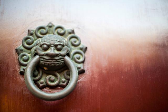 An Ornate Door Knocker Adorns A Red Door At Shanghaiu0027s City God Temple In  China On November 30, 2013. (Tahiat Mahboob)