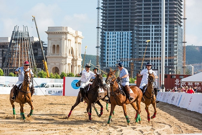 "A match is underway at the ""beach polo"" event put on by SO! Dalian. Image courtesy of Lauren Greenfield for Asia Society's ChinaFile Magazine"