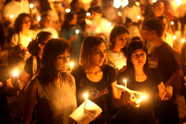 MUMBAI, INDIA - NOVEMBER 30: Mumbai residents walk with candles in the street near The Oberoi Hotel during a demonstration against the recent terror attacks in the city. (Uriel Sinai/Getty Images)