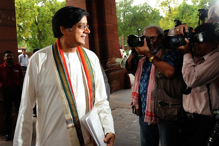 Indian Junior Foreign Minister Shashi Tharoor (L) arrives at Parliament in New Delhi on June 1, 2009. (Prakash Singh/AFP/Getty Images)