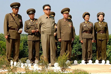 This undated picture, released from Korean Central News Agency on June 11, 2008, shows North Korean leader Kim Jong Il (L) inspecting Korean People's Army unit 958 at an undisclosed location. (STR/AFP/Getty Images)