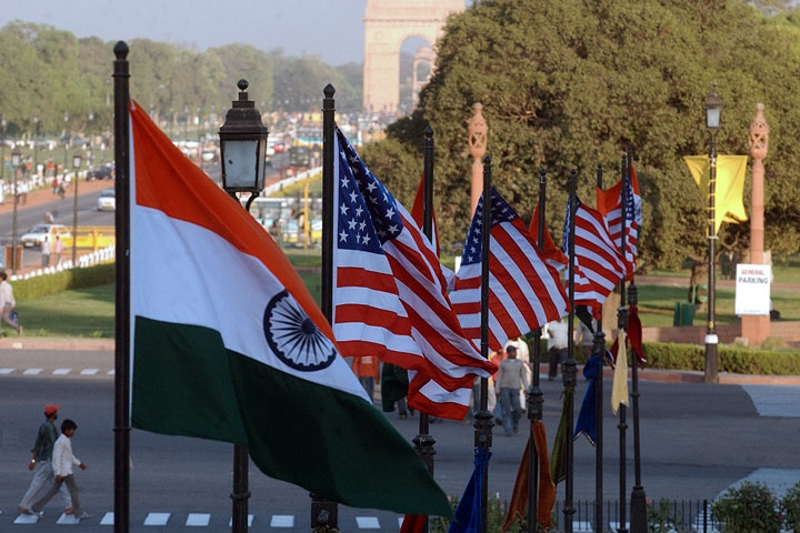 US and Indian flags fly on Rajpath in front of India Gate in New Delhi. (Manpreet Romana/AFP/Getty Images)
