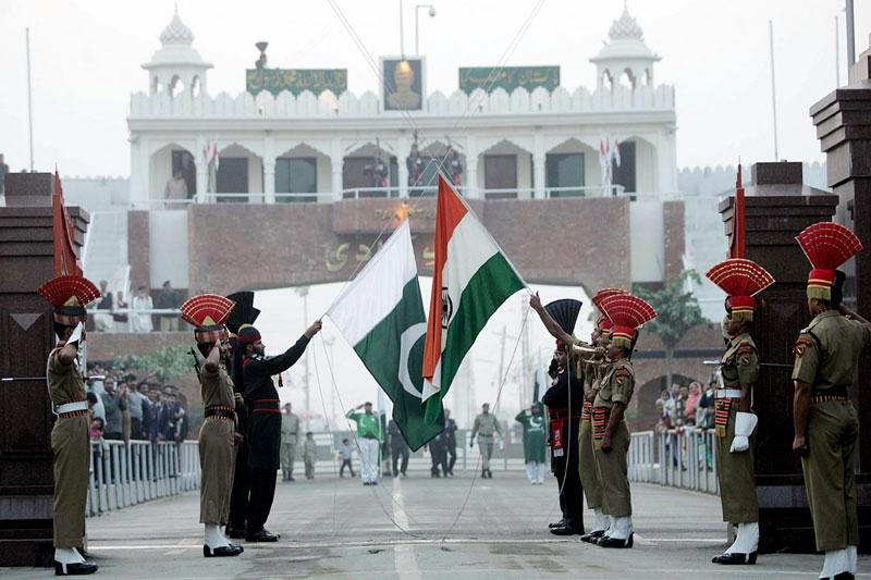 Pakistani Rangers (in black) and Indian Border Security Force personnel perform the daily retreat ceremony on the India-Pakistan border at Wagah in Dec. 2008. (Narinder Nanu/AFP/Getty Images)