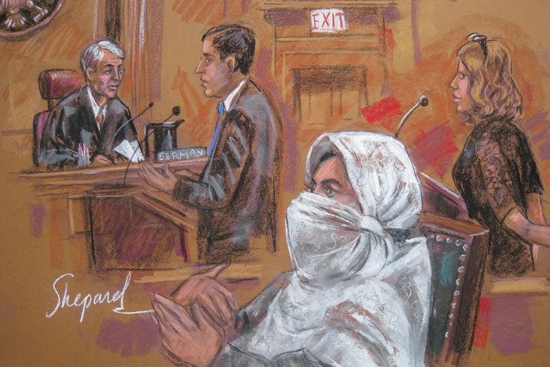 This September 23, 2010 courtroom drawing shows Pakistani scientist Dr. Aafia Siddiqui (C) with Judge Richard Berman (L), US Assistant Attorney Christopher LaVigne (2ndL) and Attorney Linda Moreno (R) in New York. A US federal court Thursday sentenced Aafia Siddiqui to 86 years in prison for attempted murder of US officers in Afghanistan. (Shirley Shepard/AFP/Getty Images)