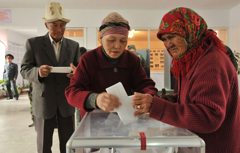 Kyrgyz women cast their votes at a polling station during the parliamentary elections in the village of Koy-Tash, some 15kms from Bishkek, on October 10, 2010. (Vyacheslav Oseledko/AFP/Getty Images)