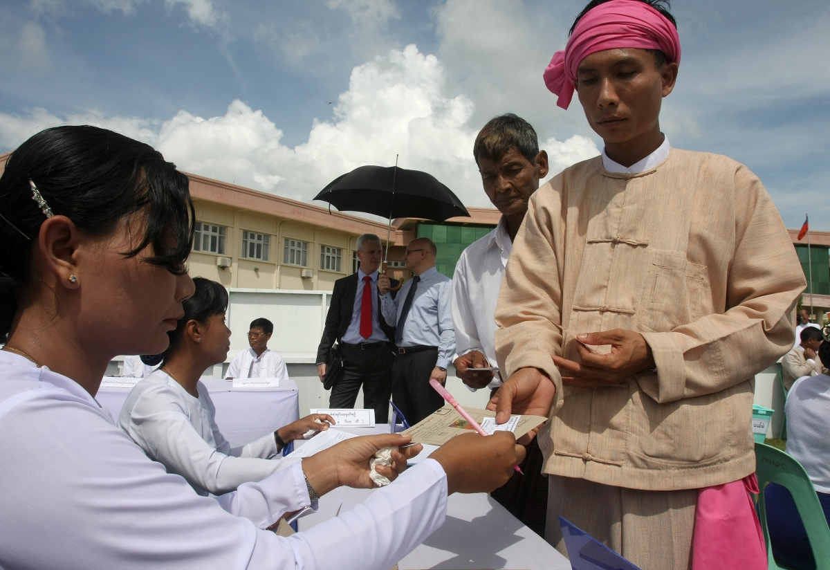 Votes queue to collect their ballot papers during a demonstration of how to vote in Naypyidaw. (Soe Than Win/AFP/Getty Images)