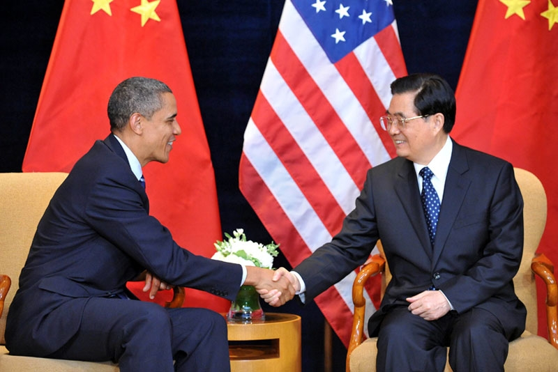 US President Barack Obama (L) shaking hands with Chinese President Hu Jintao during their bilateral meeting in Seoul at the start of the G20 summit on Nov. 11, 2010. (Tim Sloan/AFP/Getty Images)