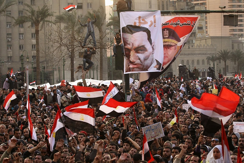 Anti-government protesters cheer in Cairo's Tahrir Square on February 8, 2011. (John Moore/Getty Images)