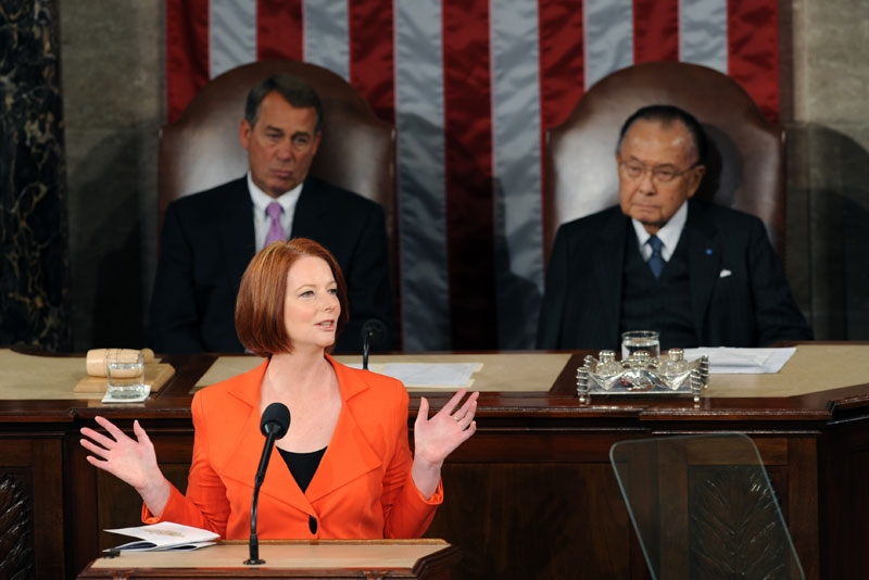 Australian Prime Minister Julia Gillard addresses the US Congress in Washington on Mar. 9, 2011. Seated behind Gillard are US Senator Daniel Inouye (D-HI) (R), and President Pro Tempore, and Speaker of the House John Boehner. (Saul Loeb/AFP/Getty Images)