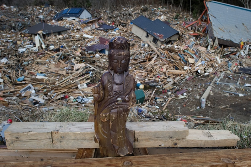 A religious statue stands among the rubble in Kesennuma, Miyagi prefecture on March 17, 2011 after the March 11 earthquake and tsunami. (NICOLAS ASFOURI/AFP/Getty Images)