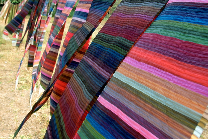 "Silk ""rainbow"" scarves by Lao Textiles, the company founded by Carol Cassidy."