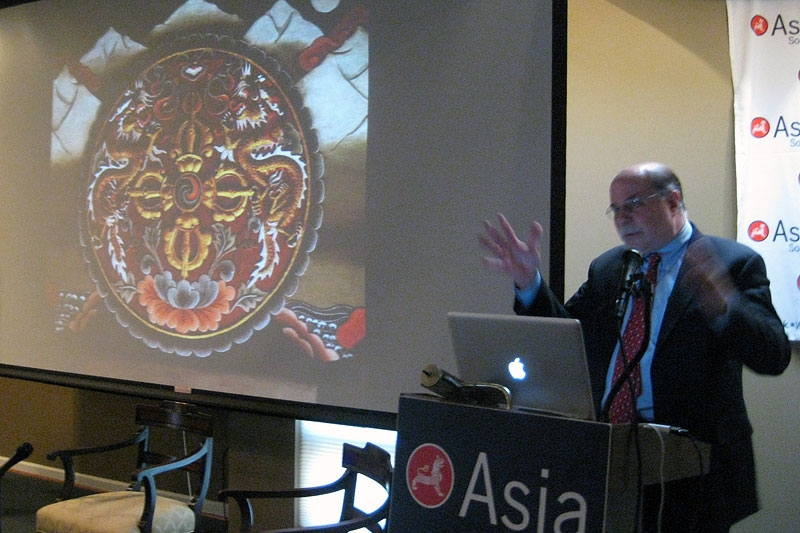 Next to a traditional Bhutanese motif, Dr. Bruce Buntling discusses modern-day Bhutan in Washington on May 5, 2011. (Asia Society Washington Center)