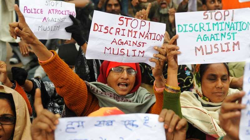Muslim women from Indian state of Gujarat shout anti-government slogans during a protest in New Delhi on December 28, 2010 against the discrimination, exclusion and persecution of Muslims. (Raveendran/AFP/Getty Images)
