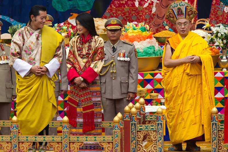 King Jigme Khesar Namgyel Wangchuck (L), 31, looks at his bride during the purification marriage ceremony to Queen Jetsun Pema, 21, in the historical Punakha Dzong on October 13, 2011 in Punakha, Bhutan. (Paula Bronstein/Getty Images)