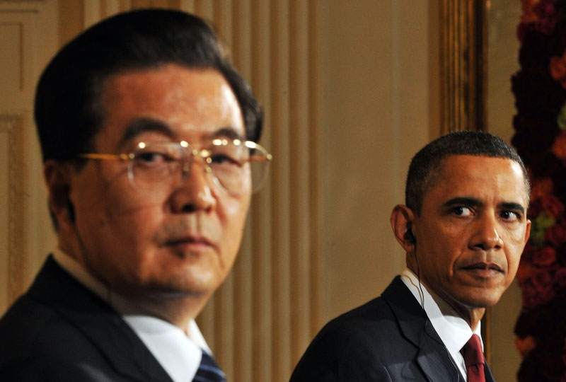 U.S. President Barack Obama (R) looks on as his Chinese counterpart Hu Jintao answers a question during a press conference in the East Room at the White House in Washington, DC, on January 19, 2011. (Mandel Ngan/AFP/Getty Images)