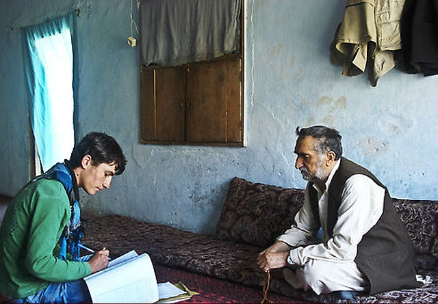 "An Afghan man being interviewed in his home in Panjshir, approximately 60 miles from Kabul, for the Asia Foundation survey ""Afghanistan in 2011."" (asiafoundation.org)"