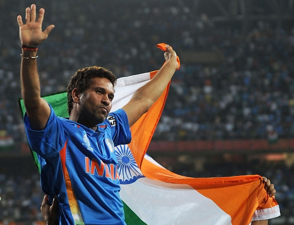 Tendulkar waves the tricolor while celebrating victory during the final of ICC Cricket world Cup 2011 match between India and Sri Lanka — Wankhede Stadium, Mumbai, on April 2, 2011. (Prakash Singh/AFP/Getty Images)