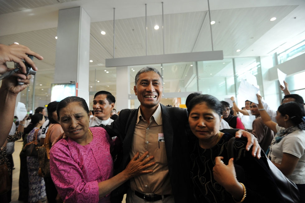 Myanmar academic Aung Naing Oo (C), who fled a brutal crackdown on student protests over two decades ago, is greeted by relatives upon his return to his homeland at Yangon International Airport on February 10, 2012. (Soe Than Win/AFP/Getty Images)