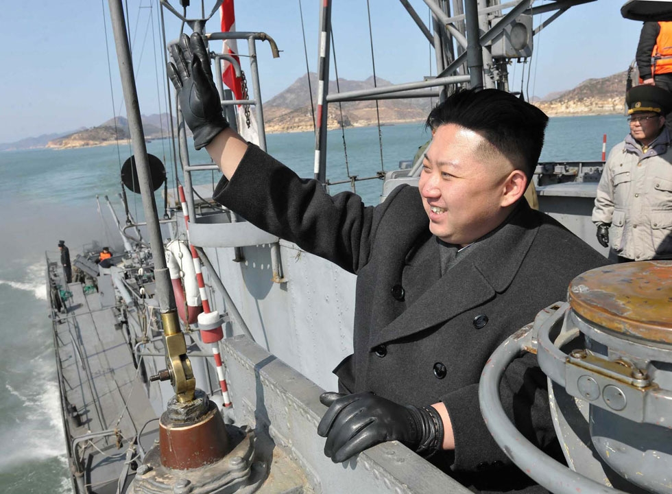 This undated picture, released from North Korea's official Korean Central News Agency on March 10, 2012 shows North Korean leader Kim Jong Un waving his hand on a naval vessel as he inspects Korean People's Army Navy Unit 123 honored with the title of O Jung Hup-led Seventh Regiment at undisclosed place in North Korea. (KNS/AFP/Getty Images)
