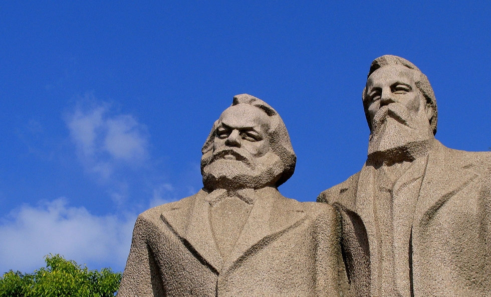 This statue of Karl Marx (L) and Friedrich Engels graces Shanghai's Fuxing Park. (Hennie Schaper/Flickr)