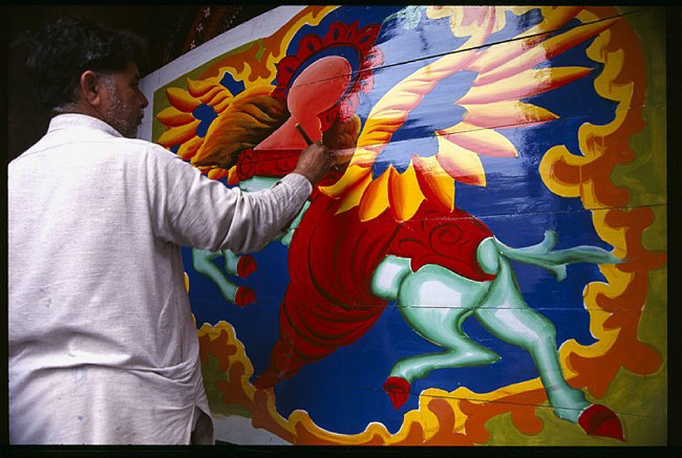 An artist painting Buraq, Prophet Mohammad's winged horse, on the side of a truck. (Peter Grant)