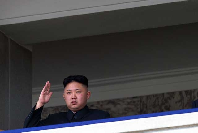 North Korean leader Kim Jong-Un salutes as he watches a military parade in Pyongyang on Apr. 15, 2012, two days after a North Korean rocket apparently exploded within minutes of blastoff and plunged into the sea. (Ed Jones/AFP/Getty Images)