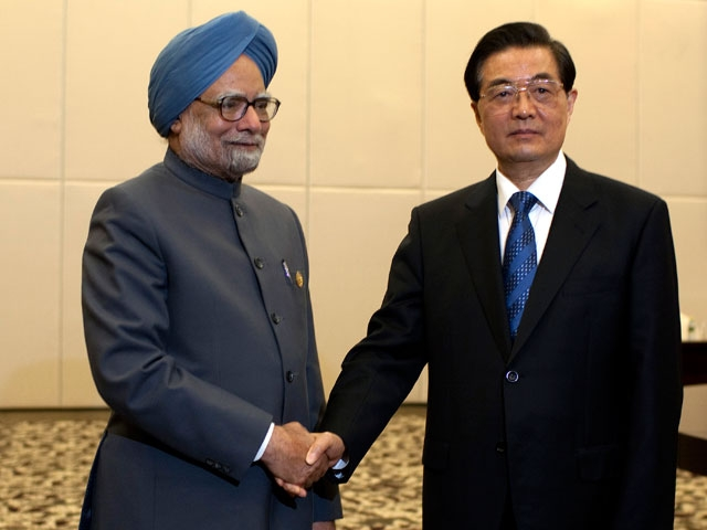 Indian Prime Minister Manmohan Singh (L) with Chinese President Hu Jintao in Sanya, China on Apr. 13, 2011. Both India and China declined to link India's missile test on Apr. 19, 2012 with the state of their relations. (Nelson Ching/AFP/Getty Images)
