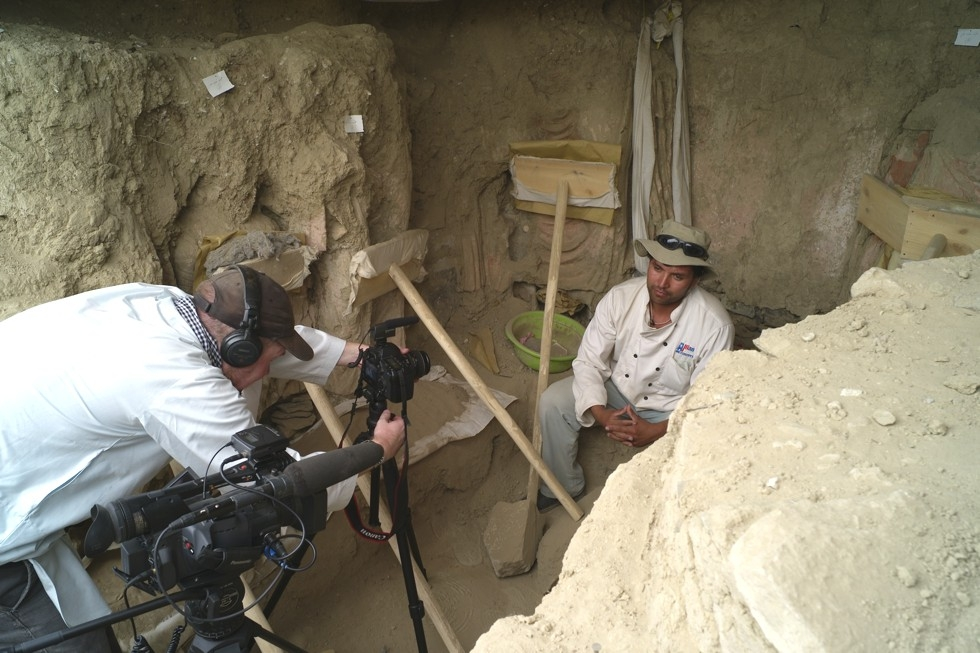 Brent Huffman interviewing lead Afghan archaeologist Abdul Qadeer Temore. (Frank Petrella)