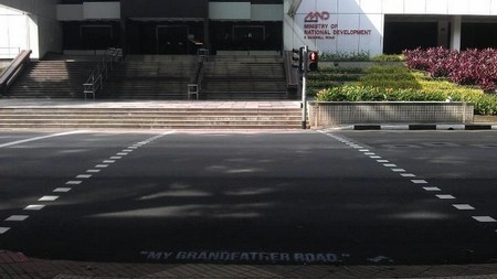 """My Grandfather Road,"" a Singlish colloquialism often used to condemn reckless drivers, spray-painted on Maxwell Road. (Samantha Lo/skl0.tumblr.com)"