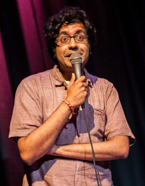 Comedian Hari Kondabolu onstage at the Nuyorican Poets Cafe on August 12, 2012. (Neha Gautam Photography)