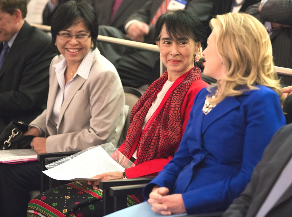 U.S. Secretary of State Hillary R. Clinton chats with Aung San Suu Kyi and her assistant Tin Mar Aung, before the Myanmar parliamentarian spoke at the U.S. Institute of Peace in Washington, D.C., Sept. 18, 2012. (Asia Society/Joshua Roberts)