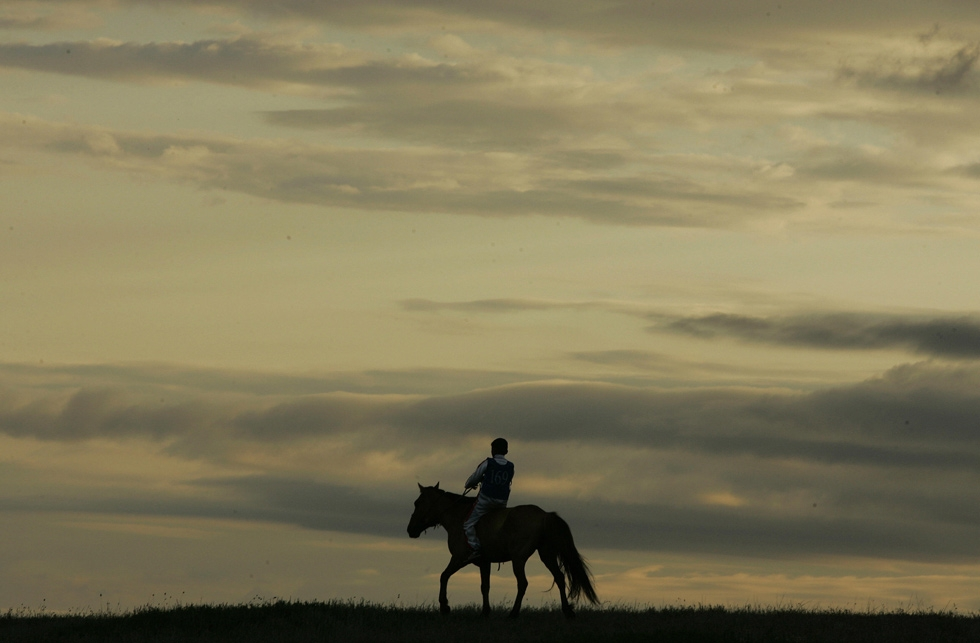 At dawn, a young Mongolian rider heads to the start of a gruelling 30km horse race during the annual Naadam festival at Khui Doloon Khudag, 40km from Ulaanbaatar. (Peter Parks/AFP/Getty Images)