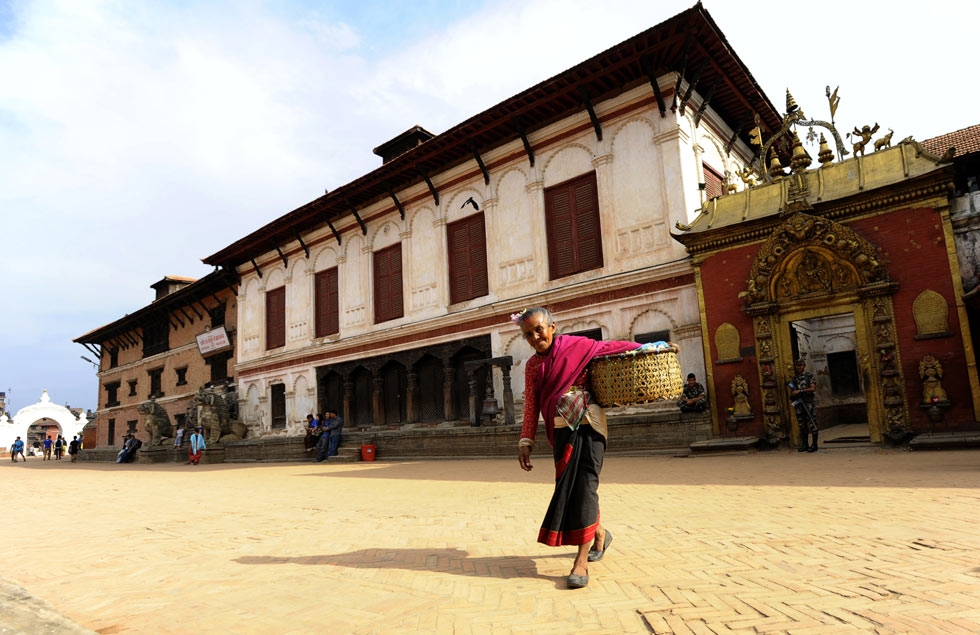 A Nepalese Hindu woman leaves a temple in Bhaktapur Durbar Square area in Bhaktapur, some 12 kilometers southeast of Kathmandu. (Prakash Mathema/AFP/Getty Images)