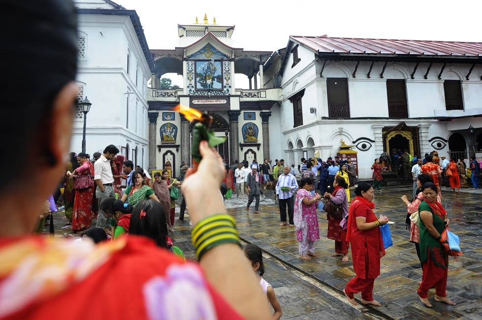 A Nepalese Hindu holds up offerings in honor of Lord Shiva at the Pashupatinath Temple in Kathmandu on July 22, 2013. (Prakash Mathema/AFP/Getty Images)
