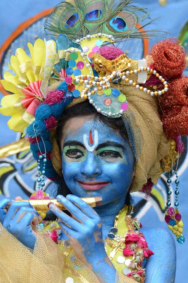 A young boy dressed as the Hindu god Krishna poses on the eve of the Janmashtami festival at a school in Amritsar on August 27, 2013. (Narinder Nanu/AFP/Getty Images)