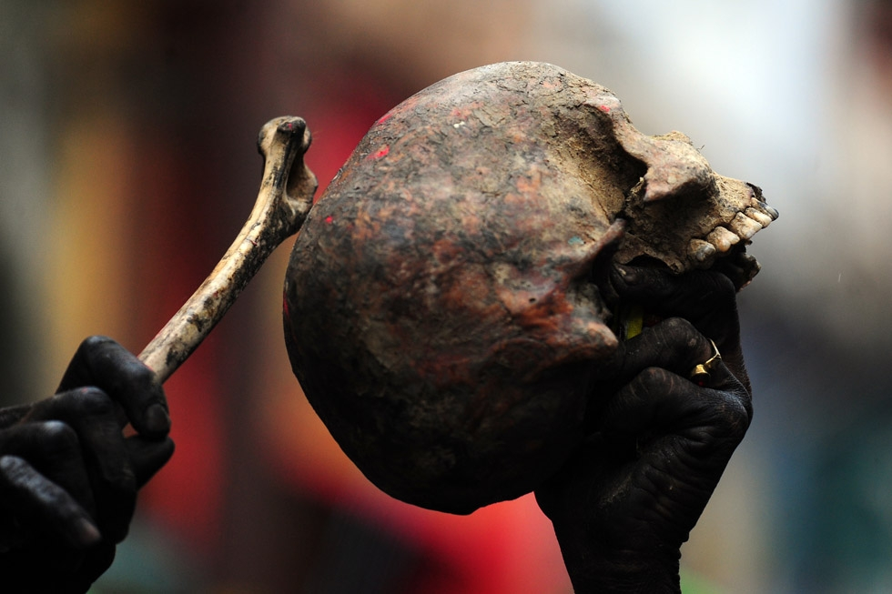 A devotee holds a human skull and bone during a procession for Maha Shivaratri in Allahabad, India on February 27, 2014. (Sanjay Kanojia/AFP/Getty Images)