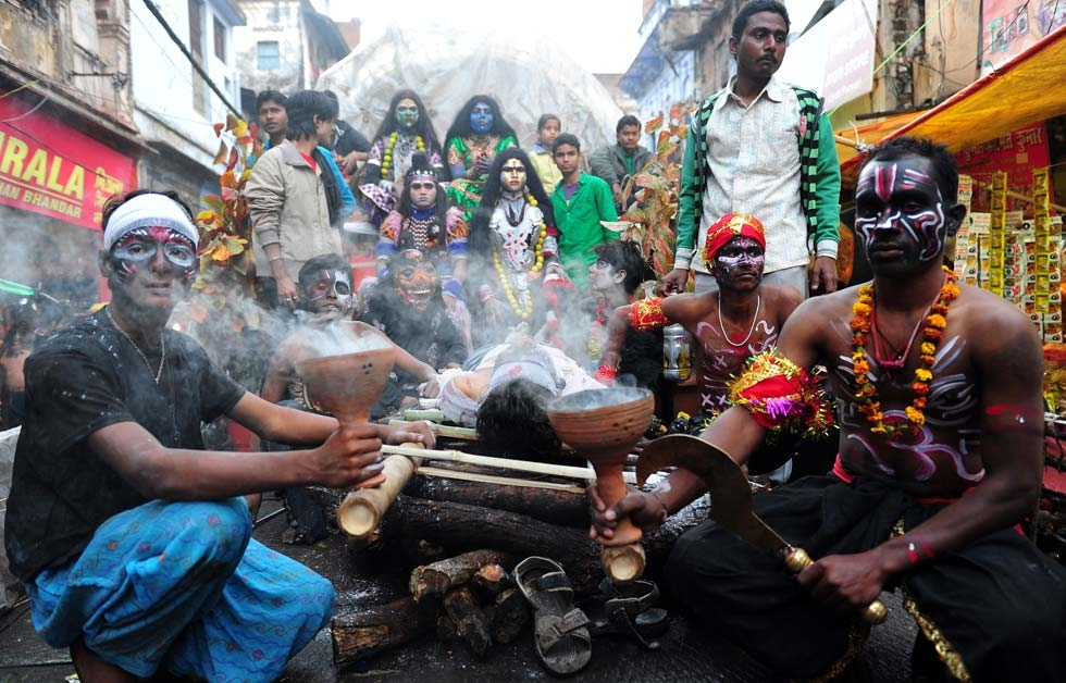 A mock cremation ritual at a procession for Maha Shivaratri in Allahabad, India on February 27, 2014. (Sanjay Kanojia/AFP/Getty Images)