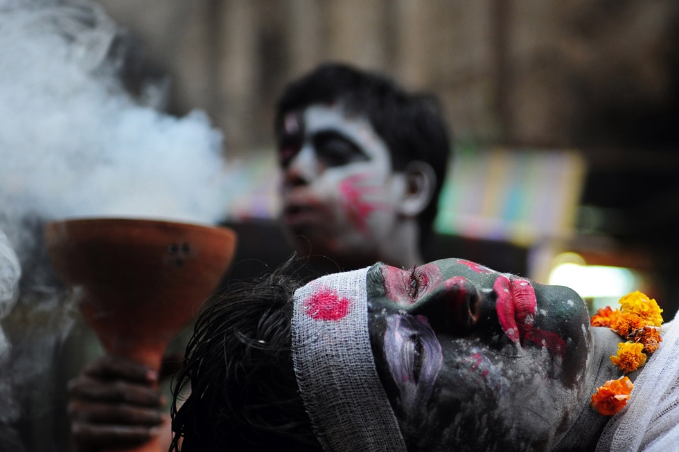 Hindu devotees perform a mock cremation ritual during a procession for Maha Shivaratri in Allahabad, India on February 27, 2014. (Sanjay Kanojia/AFP/Getty Images)