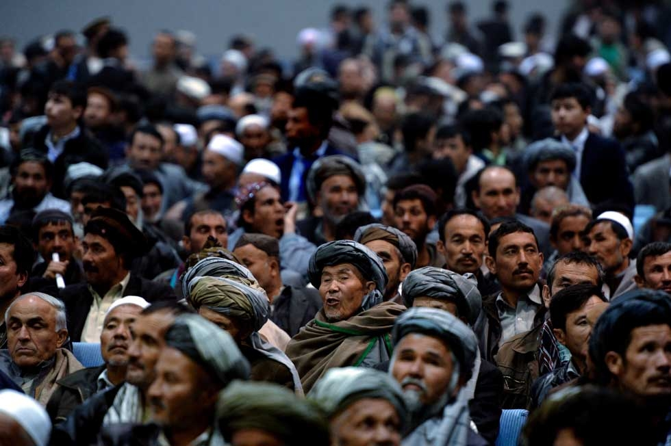 Afghan men fill a local hall as they listen to a presidential candidate during his last speech of the campaign on April 2, 2014. (Wakil Kohsar/AFP/Getty Images)