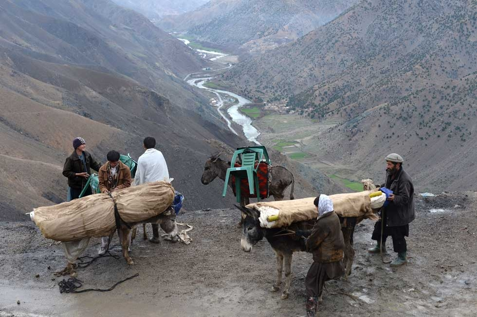 Afghan men load donkeys with election materials in the rugged mountains of the Panjshir valley on April 4, 2014. (Shah Marai/AFP/Getty Images)