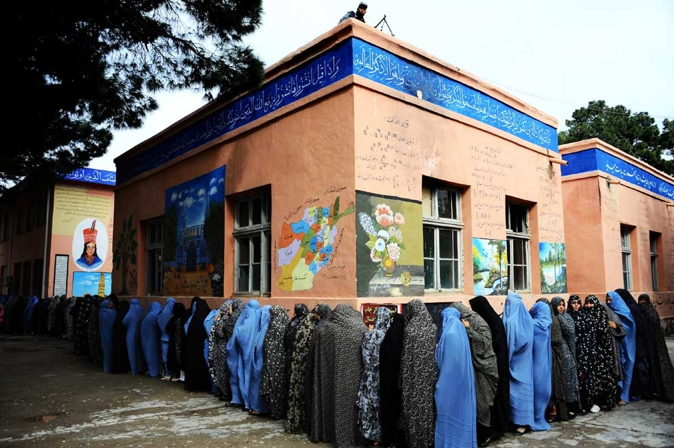 Afghan women queue outside a school to vote in presidential elections in Herat on April 5, 2014. (Aref Karimi/AFP/Getty Images)