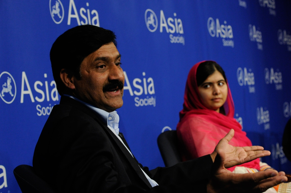 Ziauddin Yousafzai (L) and Malala Yousafzai respond to an audience question. (Elena Olivo/Asia Society)