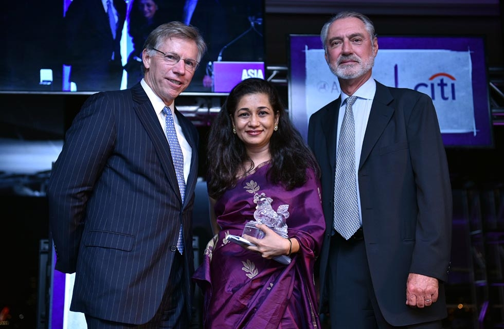 Adrian Keller (R) and Robert Niehaus (L) present Durreen Shahnaz with her Asia Game Changer Award at the United Nations on October 27, 2016. (Jamie Watts/Asia Society).
