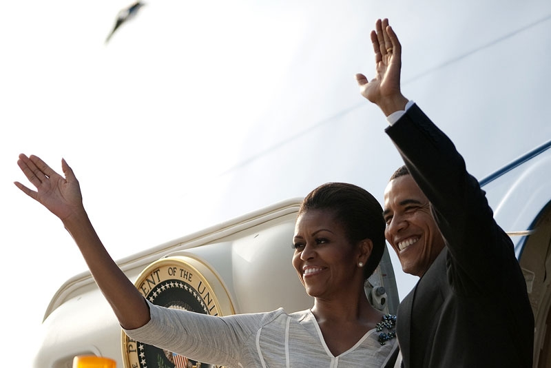 US President Barack Obama (R) and First Lady Michelle Obama wave after boarding Air Force One as they depart New Delhi on November 9, 2010. (Jim Watson/AFP/Getty Images)