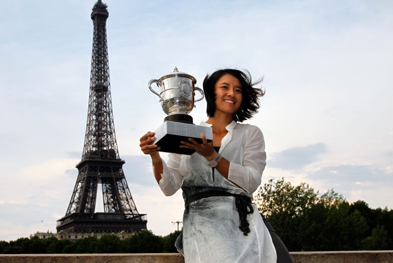 China's Li Na holds the Roland Garros French Open tennis championship trophy in front of the Eiffel Tower on June 4, 2011 in Paris a few hours after winning the French Open Women's final. Li Na made sporting history at the French Open today when she became the first player from China and from Asia to win a Grand Slam singles title. (Alexander Klein/AFP/Getty Images)