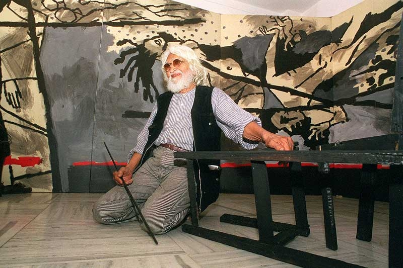 M.F. Husain (1915-2011) in March 1999, seated in front of his 40-foot (13-meter) canvas VIOLENCE at Gallery 7 in Mumbai, India. (Sebastian D'Souza/AFP/Getty Images)