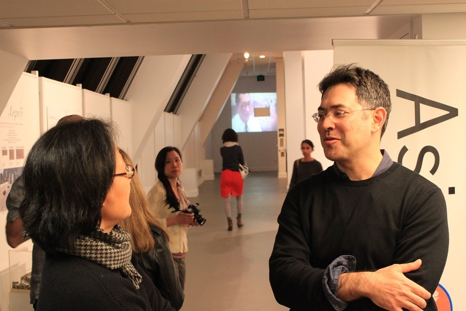 "Artist Daniel Traub talks to an attendee at ""Retrieved: The Art of Looking Back"" on February 22, 2016. ASNC partnered with the Chinese Culture Center, and featured the art and a discussion with Traub and Kurt Tong.  Lanchih Po, Professor at U.C. Berkeley, moderated the talk. (Asia Society)"