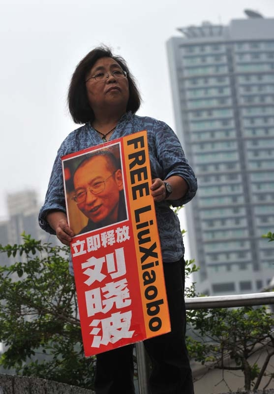 An activist holds a portrait of Liu Xiaobo in Hong Kong on May 13, 2010. (ANTONY DICKSON/AFP/Getty Images)