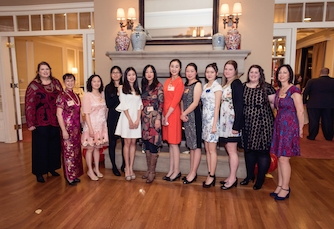 Teachers and staff members at the annual Hong Bao Gala. (Allen Cao)